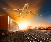 pic of railroad yard  - industry container trainst running on railways track plane cargo flying above and ship transport in import export container yard - JPG