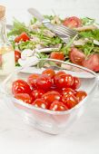 pic of plum tomato  - Small tomatoes in a glass jar with seasonal salad - JPG