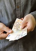 picture of holding money  - businessman hands holding european money  - JPG