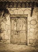 stock photo of hacienda  - Vintage style old locked colonial doors of mexican hacienda - JPG