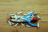 stock photo of kill  - Cigarette kills man warning concept for stop smoking - JPG