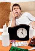 stock photo of home remedy  - Sick Teenager take a Pill on the Bed at the Home  - JPG