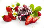 picture of strawberry  - Fresh strawberry jam in a jar of strawberries on a wooden background - JPG