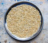 stock photo of melon  - Closeup of melon seeds kept in a plate on an blurred background - JPG