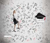 picture of graduation hat  - Young lady is going up to graduate university - JPG