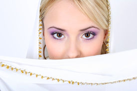 stock photo of yashmak  - young beautiful blonde with violet make - JPG