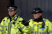 Male & female Police officers during EDL march, Luton, UK, Feb 5th 2011