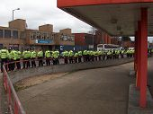 Riot Police line the route of the EDL (English Defence League) march in Luton, UK