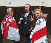 Two girls draped in England flags