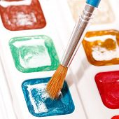 paints with brush