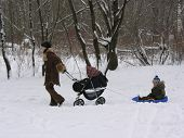 mother with children winter wood