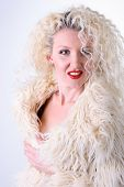 Curly Blonde In A White Fluffy Fur Coat poster