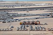 ABU DHABI, UAE - APRIL 15: Big warehouse of cars on April 15, 2010 in Abu Dhabi, UAE. Emirates national authorities have banned car import to country, if car production date more than five years ago.