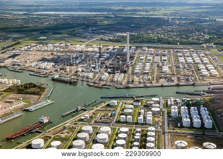 poster of Aerial View Of Oil Tankers Moored At A Oil Storage Terminal And Oil Refinery In A Port.