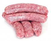a pile of pork meat sausages on a white background