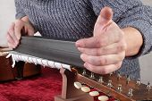 Musical Instrument Guitar Repair And Service - Worker Grinds Guitar Neck Frets. poster