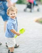 A Happy Smiling Baby Boy Walking With Young Father At Summer Park. A Family With A Cute Little Son O poster