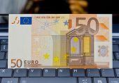Euro Banknote On Laptop's Keyboard
