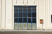 Cargo Gate Of Industrial Warehouse. Industrial Door. View On The One Gates Of Big Warehouse Facade.  poster