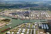 Aerial View Of Oil Tankers Moored At A Oil Storage Terminal And Oil Refinery In A Port. poster