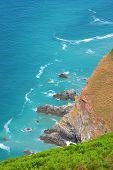 Blue Sea And Cliffs