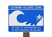 Tsunami warning zone sign isolated on white.