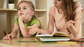 Annoyed Woman Hopelessly Teaching Little Girl, Naughty Daughter Ignoring Mother, Stock Footage poster