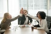 Happy Motivated Multiracial Team Giving High Five At Meeting, Diverse Group Of Colleagues Join Hands poster