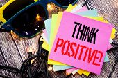 Word, Writing Think Positive. Business Concept For Positivity Attitude Written On Old Wood Wooden Ba poster