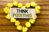 Word, Writing Think Positive. Business Concept For Positivity Attitude Written On Sticky Note Paper  poster