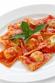 homemade ravioli pasta with tomato sauce , italian food
