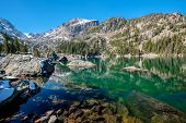 Lake Haiyaha with rocks and mountains in snow around at autumn. Rocky Mountain National Park in Colo poster