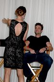 LOS ANGELES - AUG 27:  Sharon Case giving Daniel Goddard a lap dance for his birthday at Daniel Goddard Fan Event 2011 at the Universal Sheraton Hotel on August 27, 2011 in Los Angeles, CA