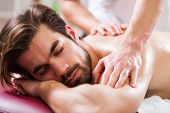 Young Man Is Enjoying Massage On Spa Treatment. poster