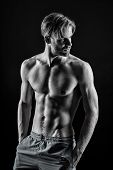Bodybuilder With Sexy Torso, Six Pack, Ab, Biceps, Triceps, Muscles. Man Athlete Show Muscular Torso poster