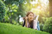 Relaxed Young Beautiful Woman With Smiling Face At The Park. Time To Relax After Work. Horizontal.bl poster