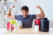 Athlete tasting new protein supplements for better muscles poster