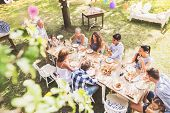 Family Celebration Outside In The Backyard. Big Garden Party. High Angle View. poster