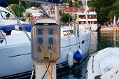 Electrical Outlets For Charging On Boats In Sea Coast In Mediterranean. Charging Station For Boats.  poster