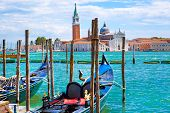 Gondolas On Grand Canal, St Mark Church Tower And Bright Turquoise Water Of Canal In Venice, Italy.  poster