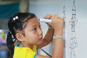 GUAYAQUIL, ECUADOR - FEBRUARY 8: Unknown kid in lesson drawing in primary school by project to help