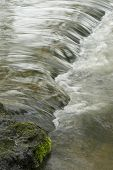 stock photo of upstream  - a fish way to enable salmon to swim upstream near a dam - JPG
