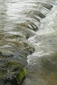 stock photo of upstream  - a fish way to enable salmon to swim upstream near a dam - JPG