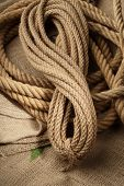 picture of naturel  - Naturel ropes twisted on a brown cloth - JPG