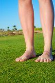 female legs on grass