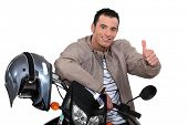 Thumbs up from a man with a motorbike
