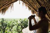 Hispanic man holding binoculars