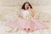 stock photo of quinceanera  - Hispanic girl on cell phone in Quinceanera dress - JPG