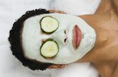 picture of man  - Mixed Race man receiving spa facial treatment - JPG