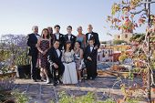 picture of quinceanera  - Hispanic family at Quinceanera - JPG
